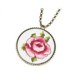 Stickpackung mit Stickgarn und Medallion - Medaillon mit Rose