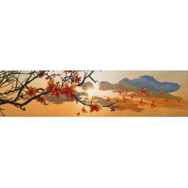 Stickpackung mit Stickgarn und Hintergrund - Sonnenuntergang im Frühling